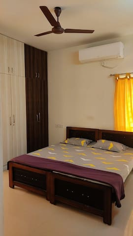 Cozy Bedroom with AC and Royal cup boards