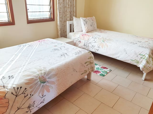 Bedroom - Flat 2 - holds a 2 x King Single beds.