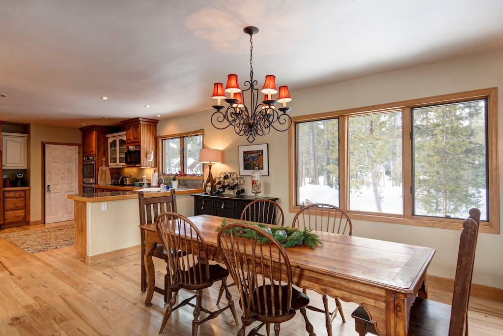 Dining room and kitchen with views out to Nordic Center and its trails, then up to Peak 8 ski trails.
