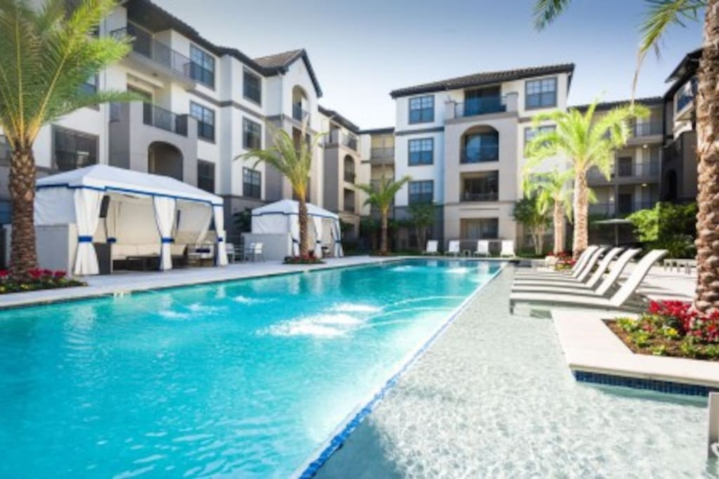 Resort style pool with cabanas