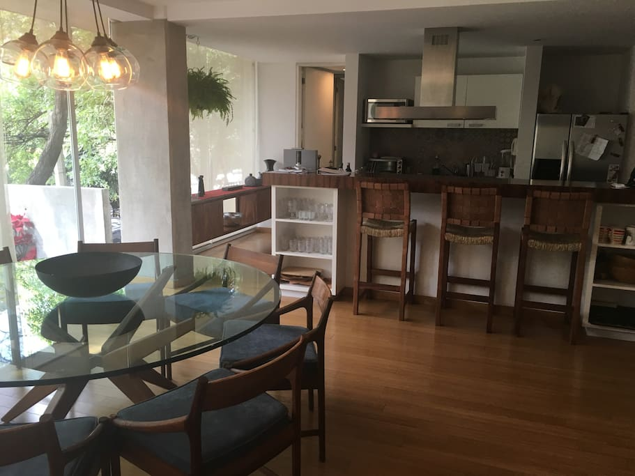 dining table next to kitchen bar