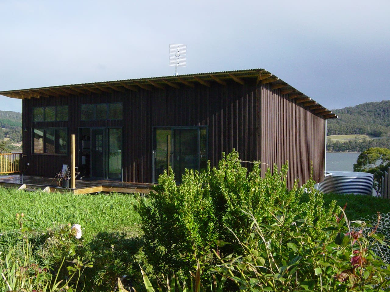 Architecturally designed eco-friendly house- garden room with back deck