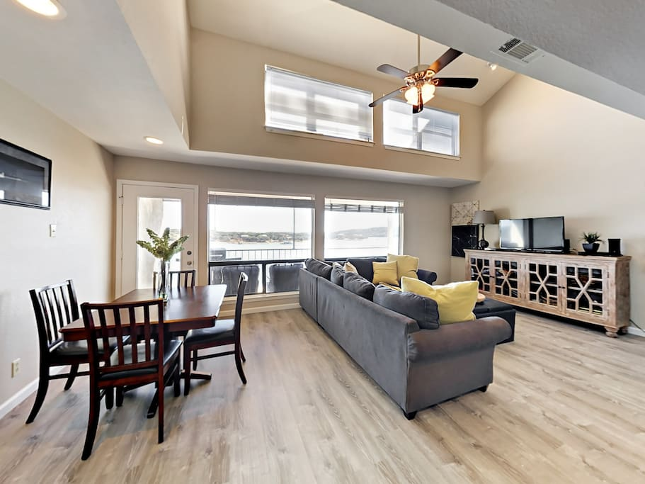 An open concept gathering area features the living room, dining room and kitchen with bar seating.