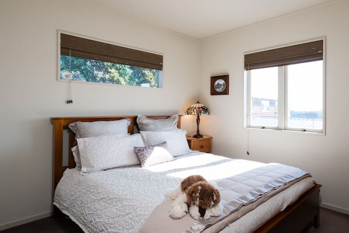 The sunny north facing bedroom has a wardrobe & comfortable chair for you to use.  There is another bedroom available in a separate listing.