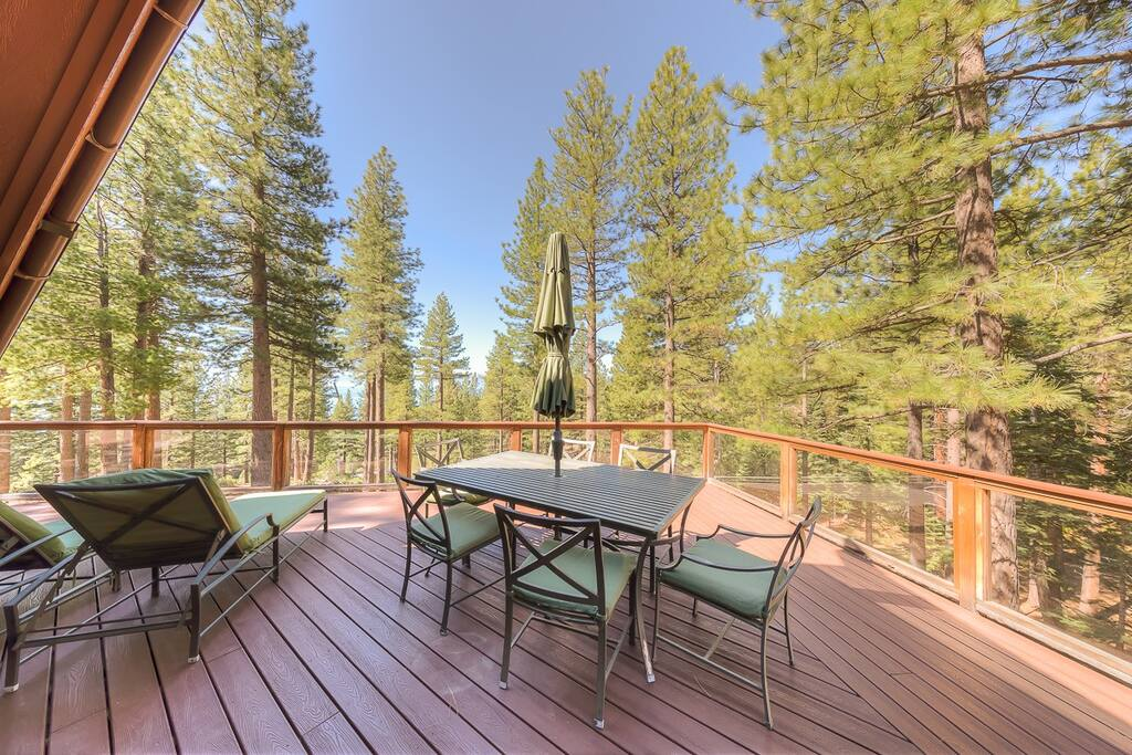 Upper Deck with eating area, gas grill, two patio heaters for those chilly Tahoe nights, and a comfortable seating area with built in gas firepit.