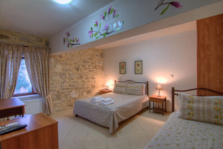 Bedroom with 1 king size bed and 1 single bed - all the bedrooms have their own bathrooms