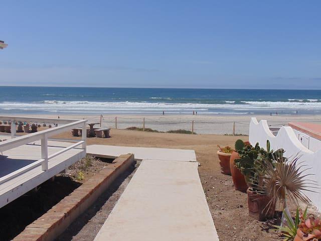 Walk to DOWNTOWN... STEPS to a SANDY BEACH!
