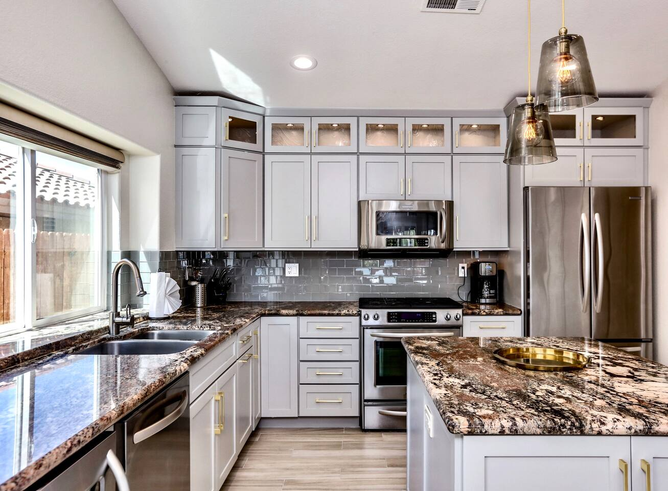 Channel your inner chef in the sparkling kitchen, detailed with stainless steel appliances and granite countertops