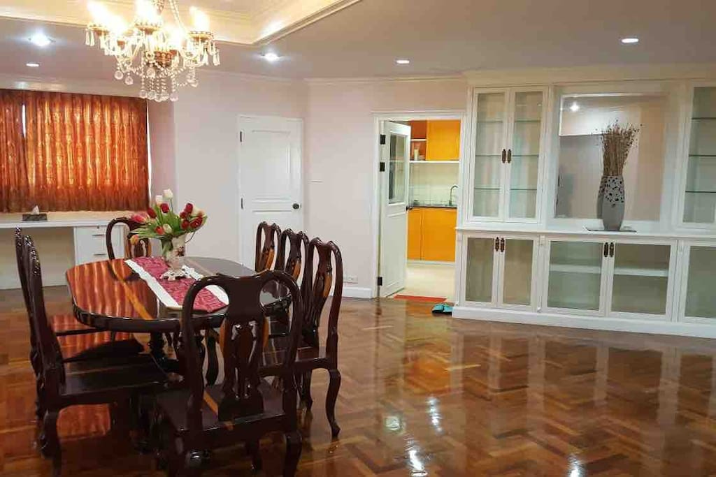 Dining table conveniently situated right outside the kitchen.