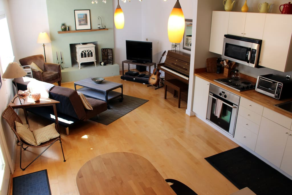 Large space includes kitchen, living and dining space.