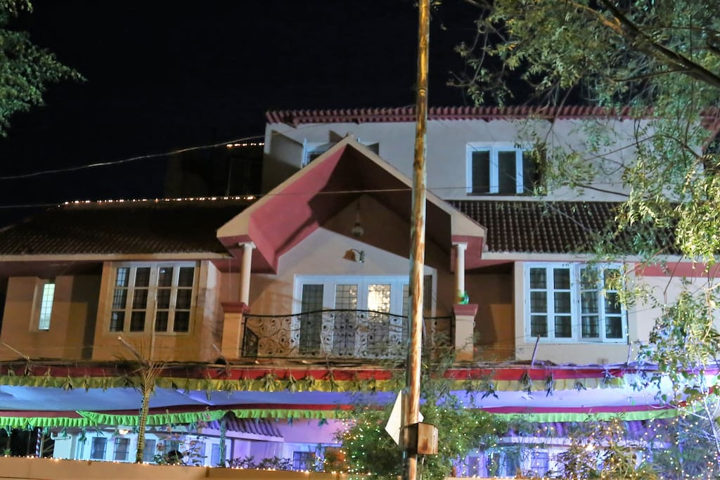 Fiesta Villa, illuminated and decorated with a traditional pandal for a pellikuturu function.
