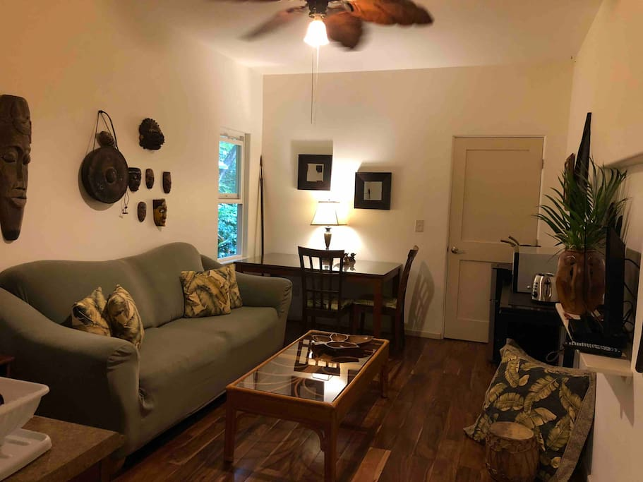 Enjoy your own private suite/studio in paradise. The living area has a comfortable couch and TV area and is also equipped with a mini refrigerator,  Nuwave cooktop, and toaster.