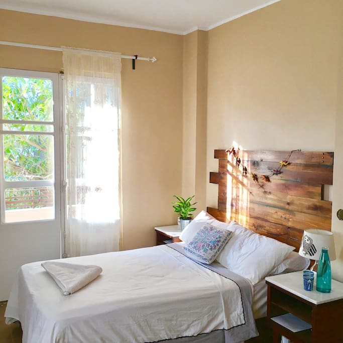 Your sunny bedroom with your private entrance to the balcony.