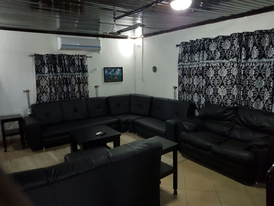 Wide expansive sitting room, with 10 to 12 seater sofa chairs, fully air conditioned with also ceiling fan, centre table, leg rest and multiple side/coffee table. Digital satellite TV with full package for view. Wifi in vantage points in the house.