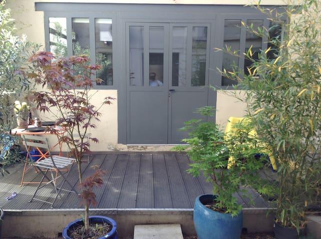Loft d'architecte hypercentre avec terrasse.