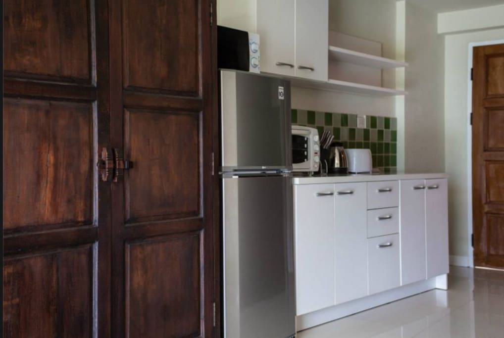 Spacious Kitchen area with all mod-cons: Fridge-Freezer, toaster-oven, microwave etc