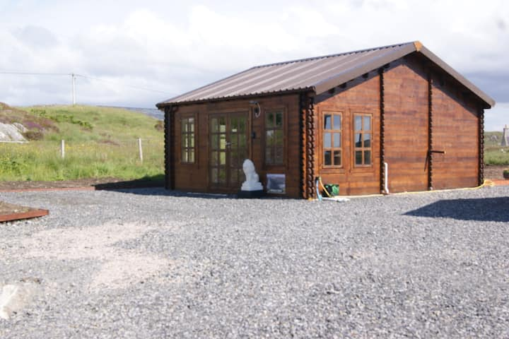 Log cabin beside historic Broch