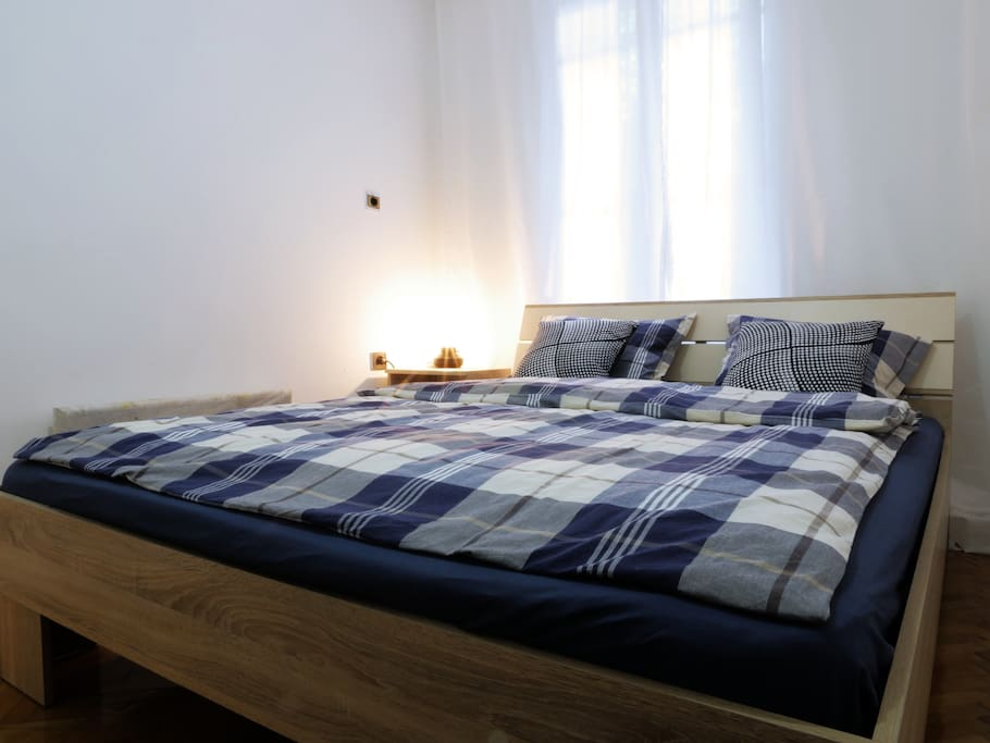 The bedroom is equipped with a queen size bed, many comfortable cushions and pleasant lamp. There is also space for your clothes with hanger and additional TV
