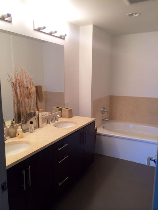 En suite bathroom w/ double sinks.