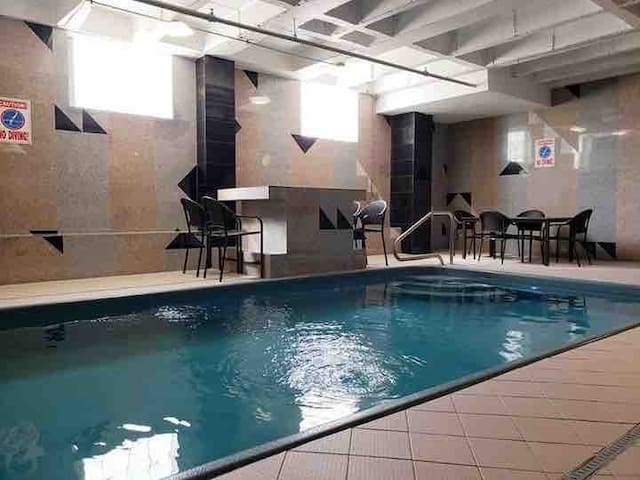 Upscale city apt with heated pool & indoor hot tub