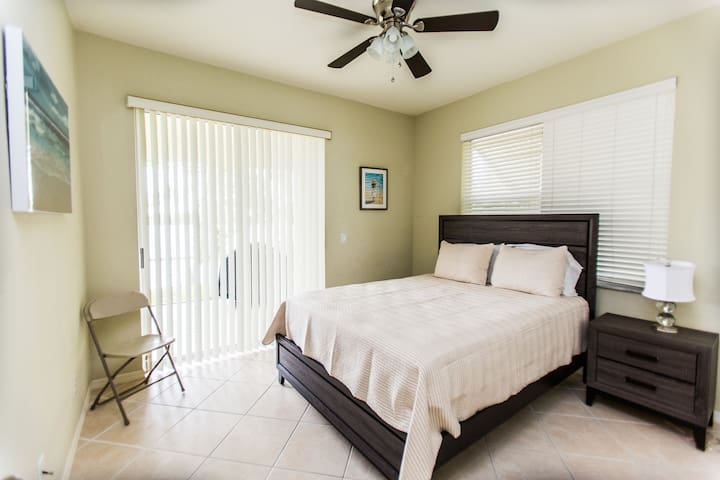 This is the second bedroom - has a sliding door to access the lanai - bathroom is shared with the 3rd bedroom