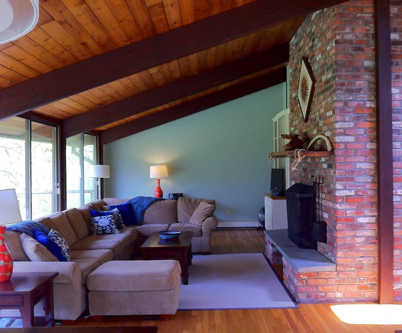 Open living area is filled with natural light. The huge sectional is a comfy place to gather.