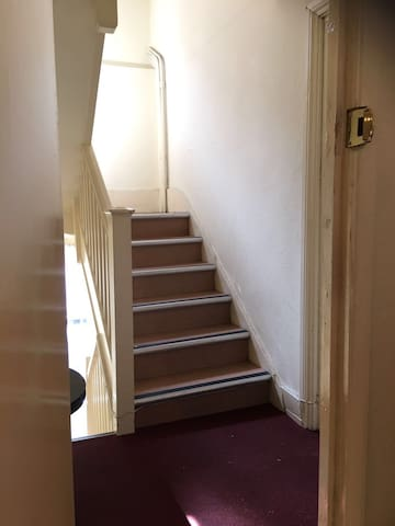 Communal staircase in front of the room. Rest of the flat is just next door.