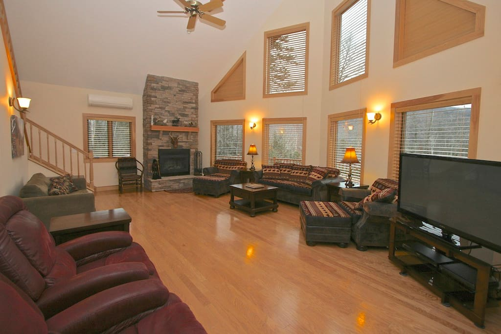 Main Living Room with wood burning fireplace. Open to kitchen and dining areas