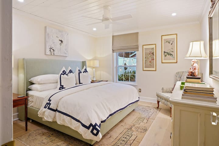 Indulge yourself in this dreamy & inspiring master bedroom with King bed dressed in crisp white, Suzanne Kasler linens, and ultra luxurious mattress & pillows.