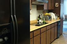 Galley kitchen with guest shelf in the refrigerator
