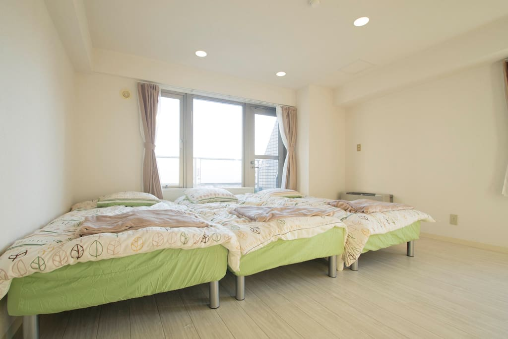 3 single beds in spacious bedroom
