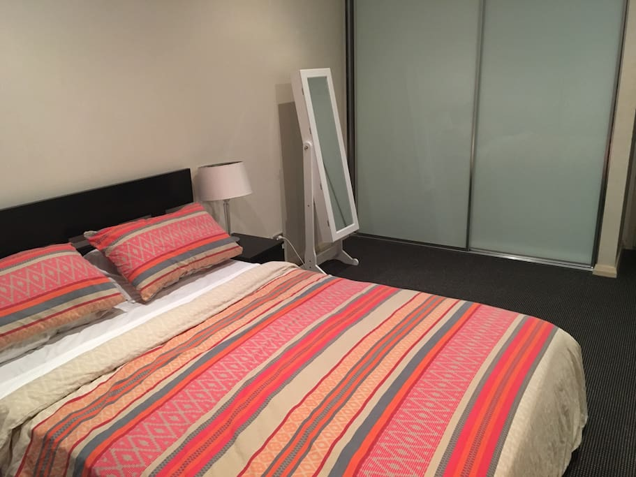 Main bedroom with Queen Sized Bed with adjoining balcony & ensuite with separate bath and shower.