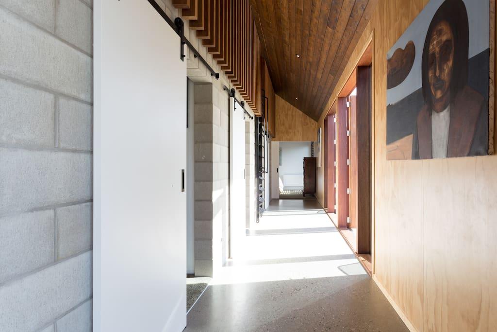Hallway to bedrooms/Loft above