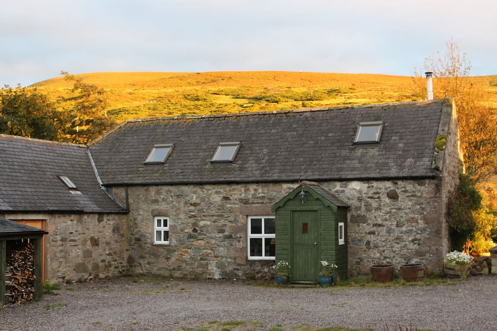 Cottage attached to woodshed and whisky den