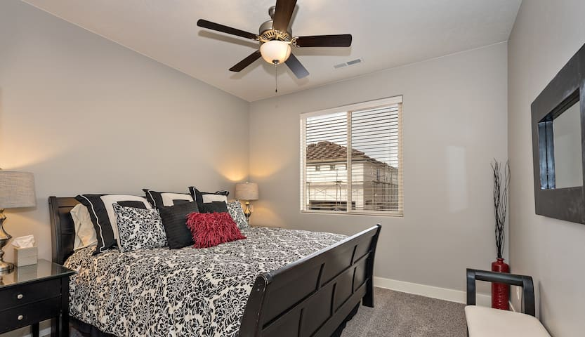 Upstairs bedroom with private bathroom & walk-in closet.  The walk-in closet is large enough to set up a pack-n-play.  Yes, we have a pack-n-play at this executive townhome.