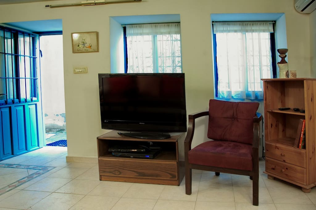 TV with DVD in lounge. Entrance to the flat is on the left