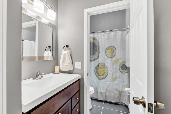 Full-Bath: Locking door; closet contains cleaning supplies, bathing supplies, towels, washcloths, hair-dryer, first-aid kit, and more