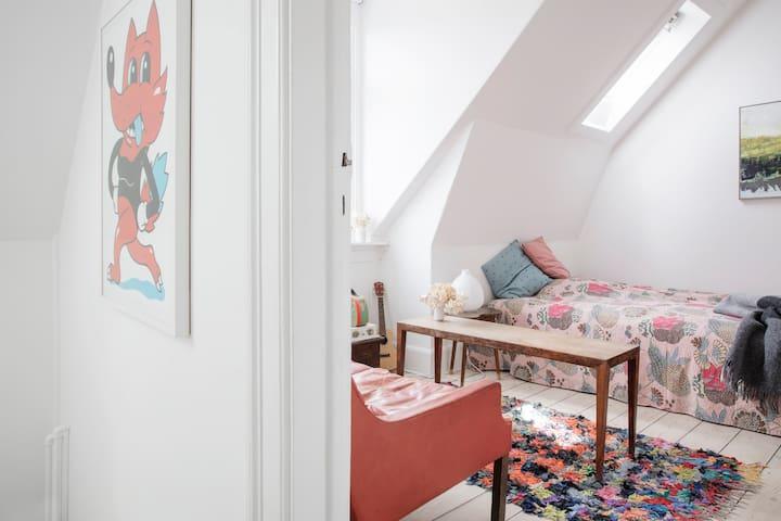 Top floor guest room with queen bed