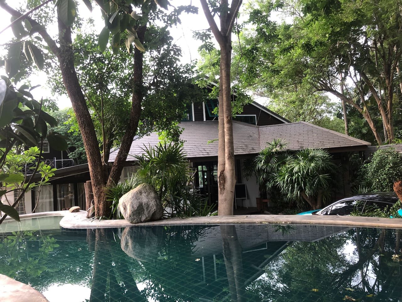 The biggest room on the west side of main house behind the natural style swimming pool and spa.