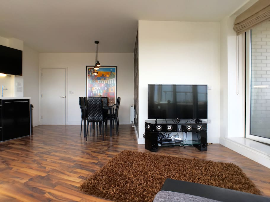 """Living area with 50"""" TV"""