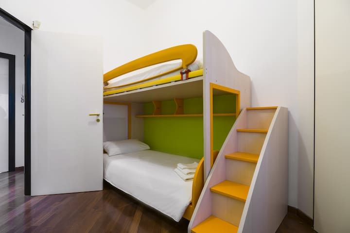 The third bedroom has a bunk bed.