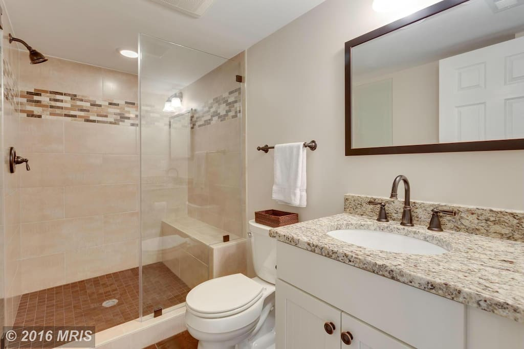 Private bathroom with shower seat