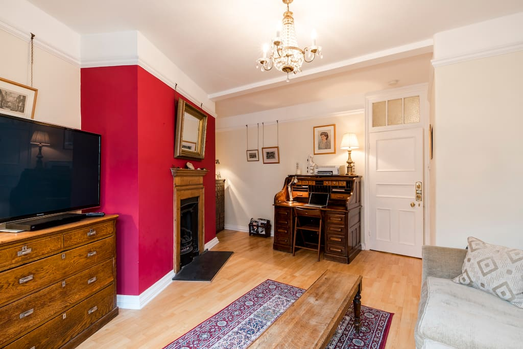 """Spacious, light and airy lounge, with coal-effect gas fire and 50"""" HDTV."""