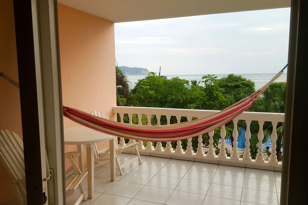 Ocean view balcony overlooking pool and garden ready for your relaxation.