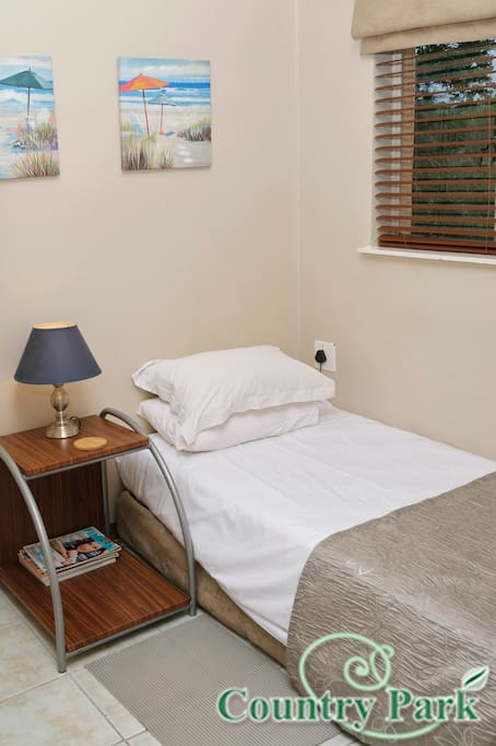UNIT 6: Single bed in open plan sleep area.  Unit 6 sleeps 5 persons in total