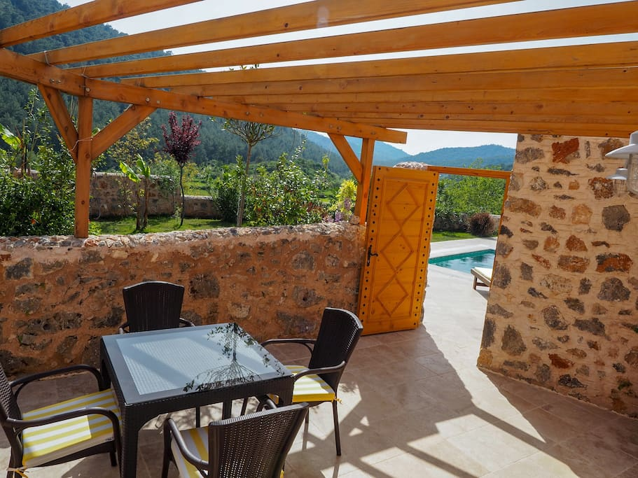 The suite has its own private outdoor terrace (20m² / 215ft²), offering supreme views of the Kaya Valley and lush green hills.