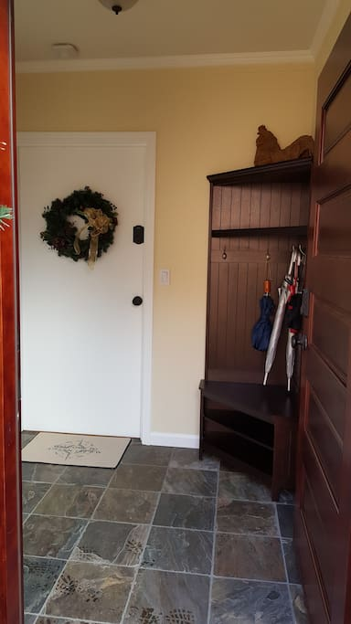 Private entrance to mud/laundry room and front door