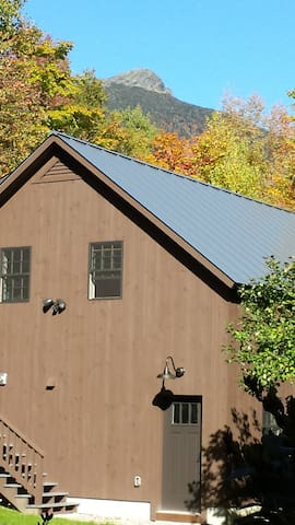 View of Camels Hump behind carriage house