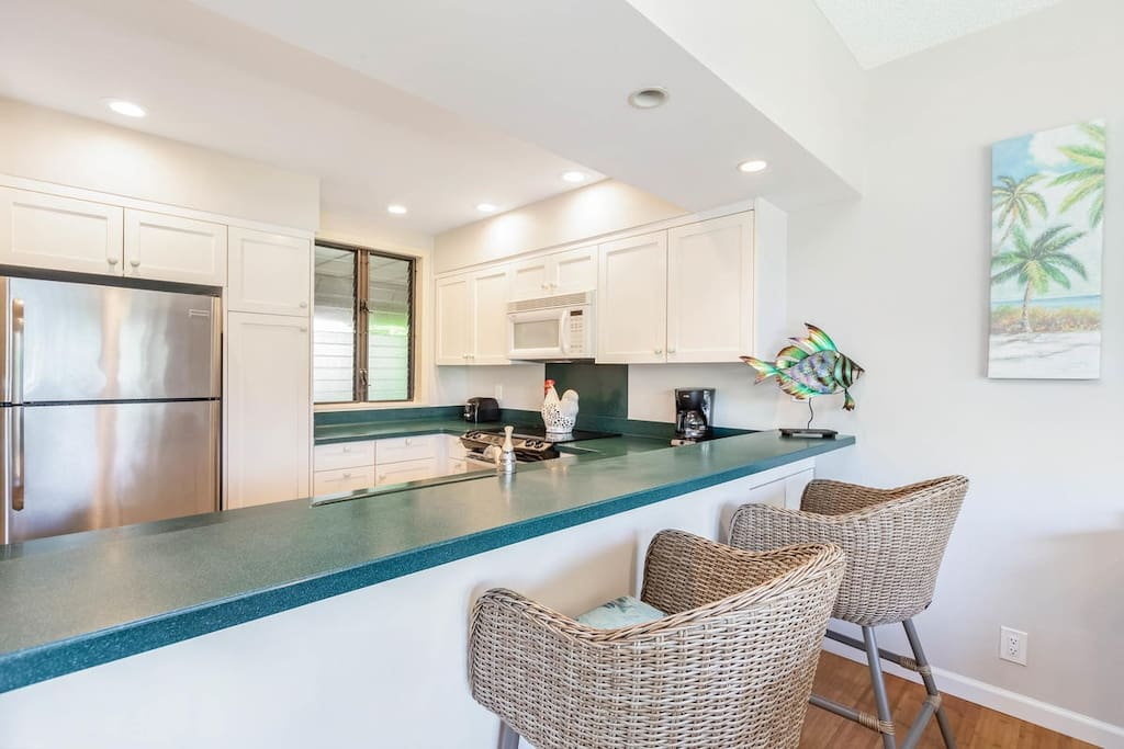 The kitchen even has bar seating; pull up a chair to spend time together during meal preparation.