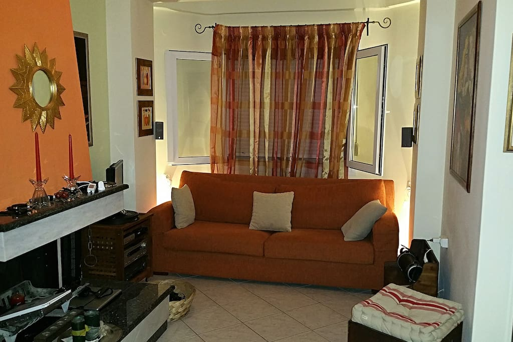 The LIVING ROOM. The first  confortable couch